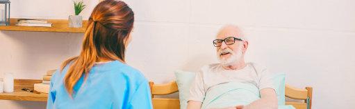 senior man talking to her caregiver